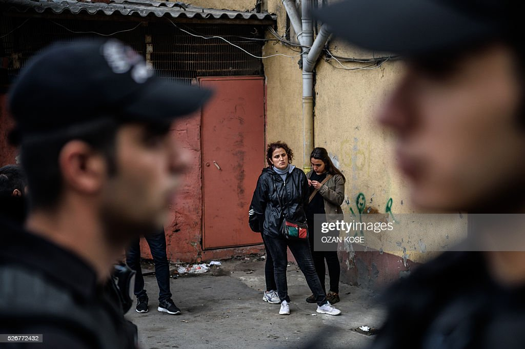 Demonstrators wait after being detained during a May Day rally in Sisli, a district of Istanbul, on May 1, 2016. Turkish labour activists and leftists marked the annual May Day holiday, with thousands of security deployed and bracing for trouble after the authorities refused to allow protests in central Taksim Square. / AFP / OZAN