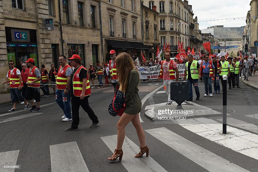 Demonstrators walk during a protest against proposed labour law reforms in Bordeaux on June 28, 2016. Unions have called repeated strikes and marches against controversial labour reforms, forced through by the government of Socialist President Francois Hollande. / AFP / NICOLAS