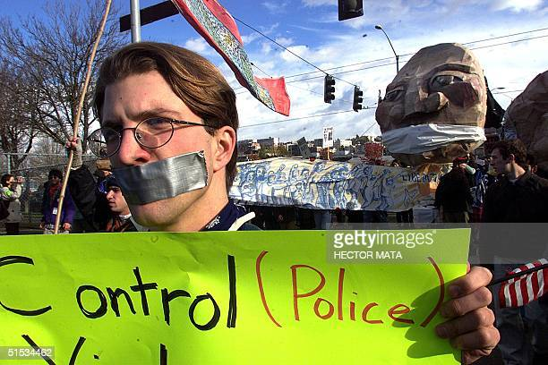 Demonstrators walk the streets of Seattle as they protest against the World Trade Organization 02 December 1999 A curfew imposed after violent...