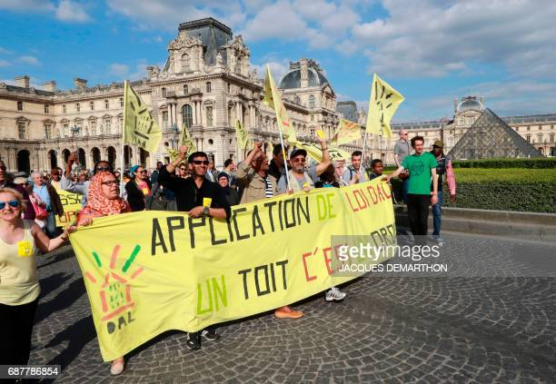 Demonstrators walk with a banner reading 'Application of the DALD law having a roof is a right' during a march organised by the association 'Droit Au...
