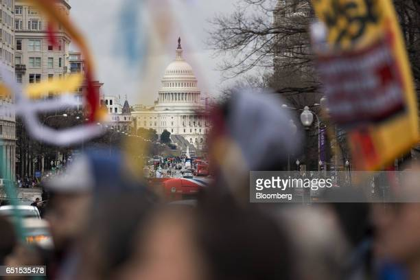 Demonstrators walks past the US Capitol during a protest against the Dakota Access Pipeline in Washington DC US on Friday March 10 2017 The Standing...
