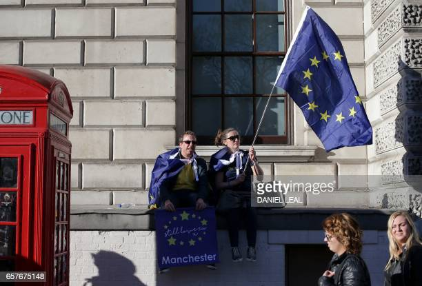 Demonstrators wave an EU flag during a rally following an anti Brexit proEuropean Union march in London on March 25 ahead of the British government's...