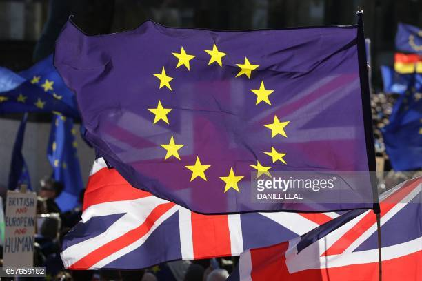 Demonstrators wave EU flags and Union Flags in Parliament Square during an antiBrexit proEuropean Union march in central London on March 25 ahead of...
