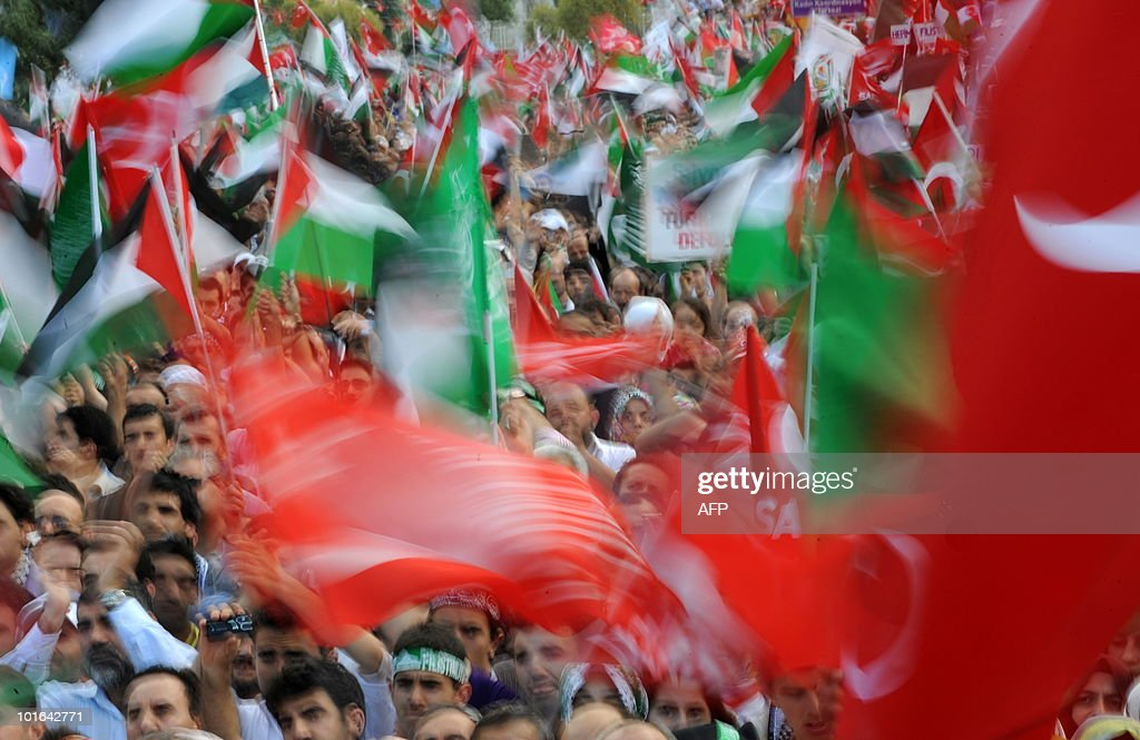 Demonstrators wave Palestinian and Turkish flags during a protest against Israel on June 5, 2010 at Caglayan Square in Istanbul. Nine people -- eight Turks and a US national of Turkish origin were killed in May 31's pre-dawn raid by Israeli forces on the Turkish ferry, Mavi Marmara, the lead ship in the aid flotilla aiming to break the crippling blockade of Gaza.