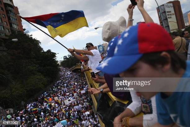 Demonstrators wave Venezuelan flags as thousands of protesters march in one of the largest antigovernment demonstrations yet on March 2 2014 in...