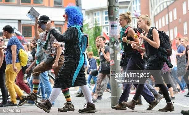 Demonstrators wear costumes as they gather for 'Grenzenlose Solidaritaet statt G20' during a protesters march against the G20 Summit on July 8 2017...