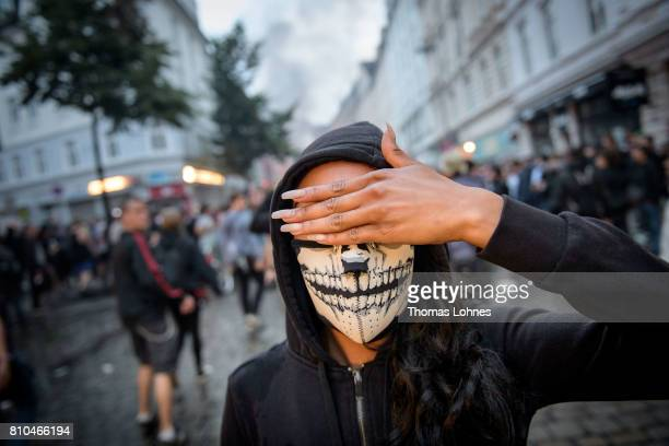 A demonstrators wears a mask during a demonstration against the G20 Summit on July 7 2017 in Hamburg Germany Leaders of the G20 group of nations are...