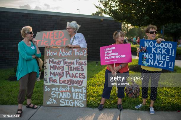 Demonstrators who did not obtain a lottery ticket for the town hall of Rep Brian Fitzpatrick RPa protest outside the meeting in Bensalem Pa on August...