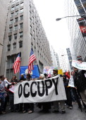 Demonstrators with 'Occupy Wall Street' march in the streets near the New York Stock Exchange as they mark the two month anniversary of the protest...