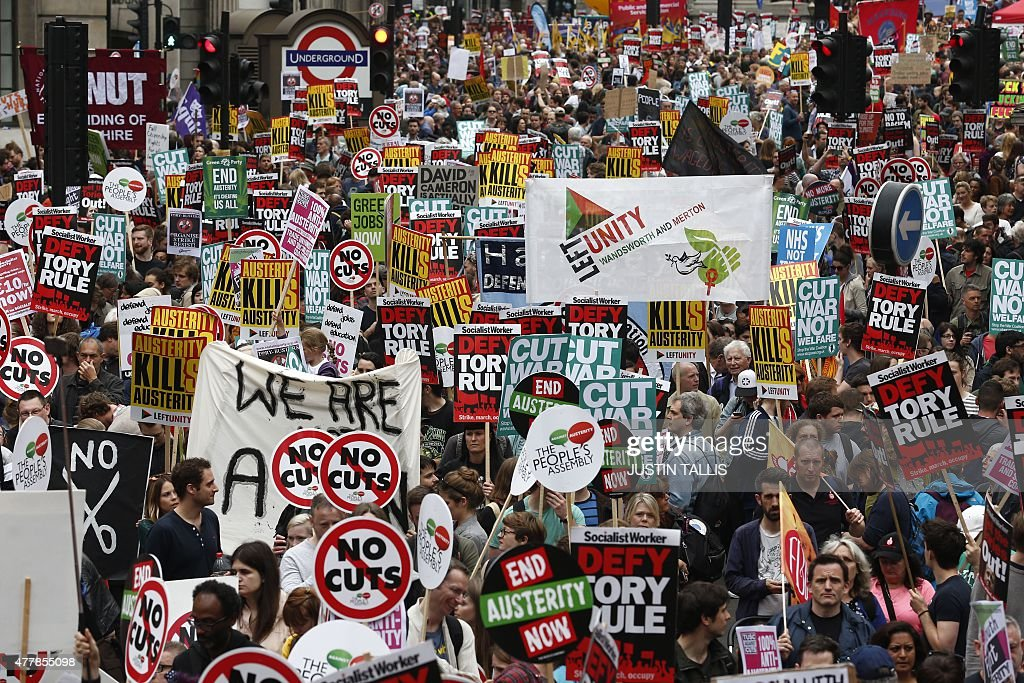Demonstrators with placards crowd the area around the Bank of England as they gather for the start of a protest against the British government's...