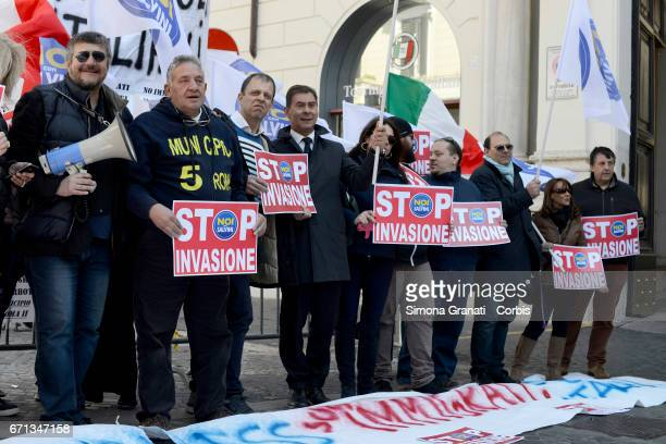 Demonstrators with signs and banners stating 'stop invasion' protest during a demonstration organized by the National Movement for Sovereignty and...