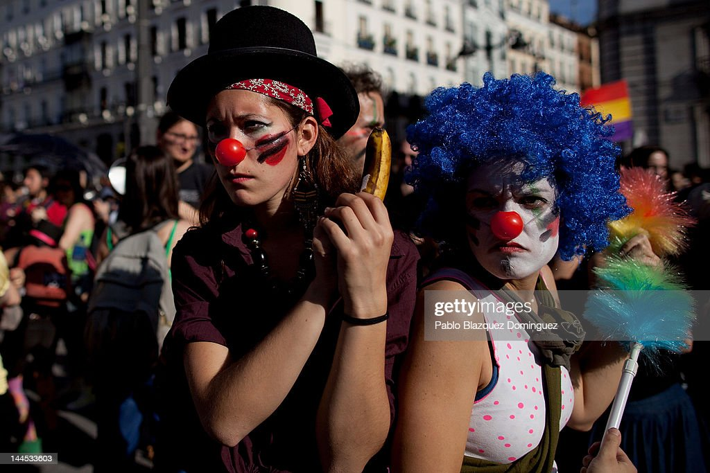 Demonstrators with Spain's Indignant movement dressed as clowns perform as policemen during a rally at Puerta del Sol on May 15, 2012 in Madrid, Spain. Spain's Indignant movement has prepared events across Spain to mark the first anniversary of their movement, formed to protest against corruption in politics, the economic crisis and the high unemployment rate. The movement's anniversary coincides with Madrid's regional festivities.