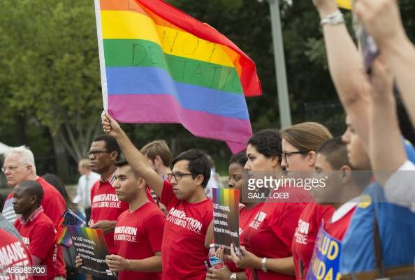 Demonstrators with the group GetEQUAL hold a protest with lesbian gay bisexual and transgender individuals affected by the country's immigration...