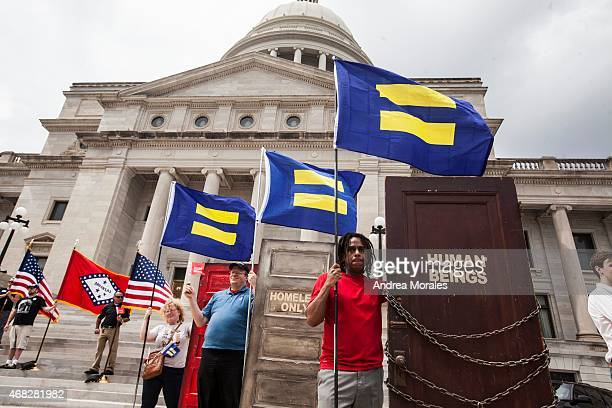 Demonstrators with the Human Rights Campaign set up outside the Arkansas State Capital in Little Rock following Gov Asa Hutchinson's comments on...