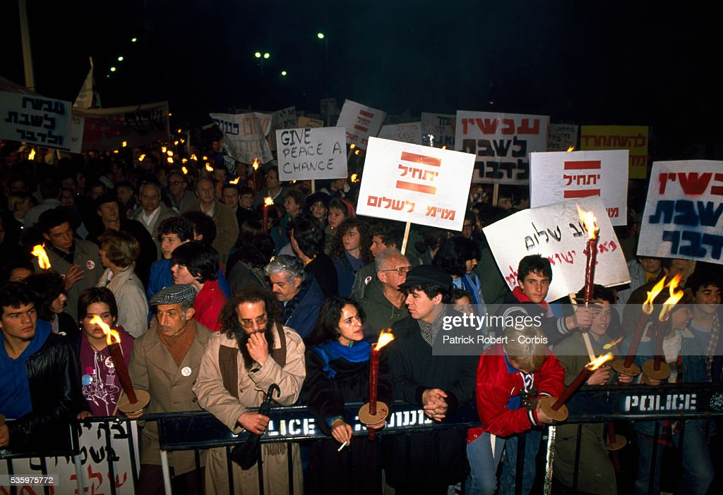 Demonstrators with the Israeli pacifist organization Peace Now protest in the streets of Jerusalem. Violence broke out after rebel Israeli and Palestinian fighters protested in the disputed territory of West Bank during the first Intifada.