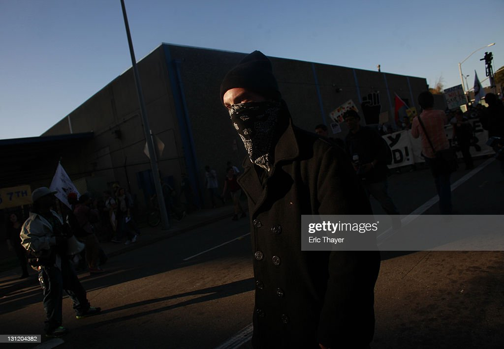 Demonstrators with the Occupy movement march on the Port of Oakland November 2, 2011 in Oakland, California. Tens of thousands of protestors have marched to the Port of Oakland for a general strike organized by Occupy Oakland. Port operations shut down for the evening.