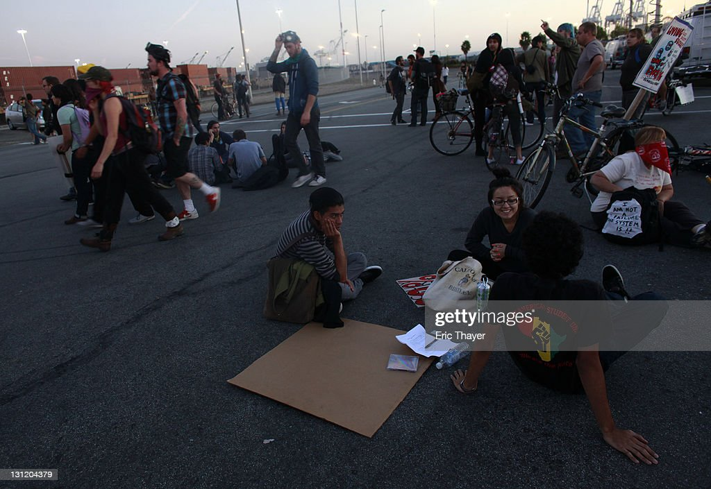 Demonstrators with the Occupy movement sit at the Port of Oakland November 2, 2011 in Oakland, California. Tens of thousands of protestors have marched to the Port of Oakland for a general strike organized by Occupy Oakland. Port operations shut down for the evening.