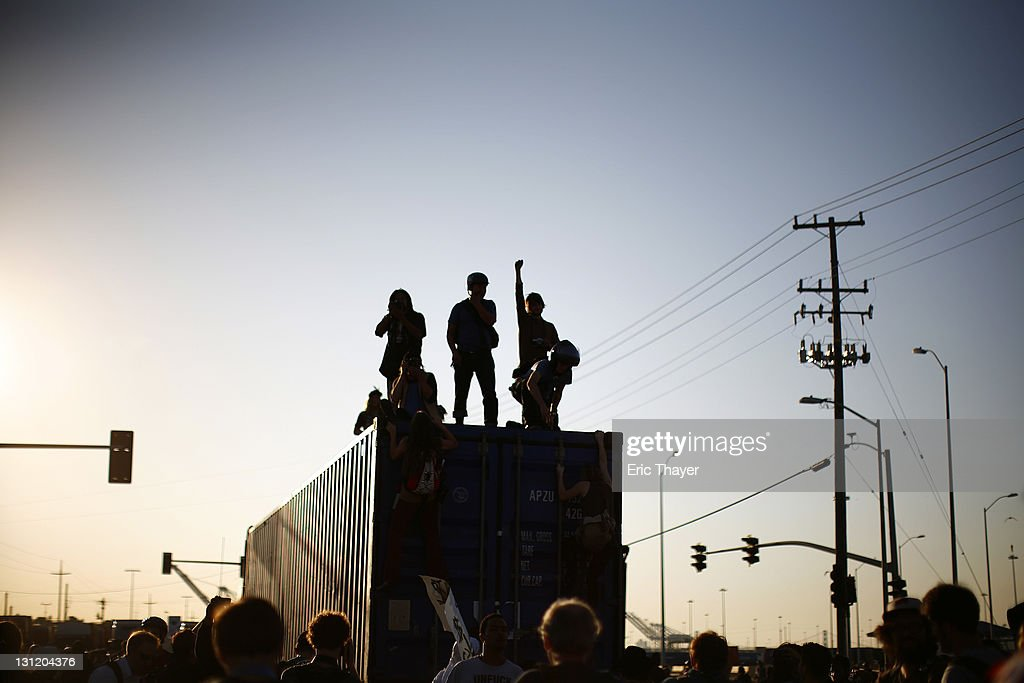 Demonstrators with the Occupy movement stand on a truck at the Port of Oakland November 2, 2011 in Oakland, California. Tens of thousands of protestors have marched to the Port of Oakland for a general strike organized by Occupy Oakland. Port operations shut down for the evening.