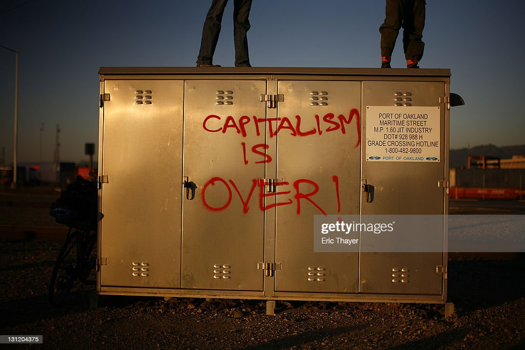 Demonstrators with the Occupy movement stand on a utility box at the Port of Oakland November 2, 2011 in Oakland, California. Tens of thousands of protestors have marched to the Port of Oakland for a general strike organized by Occupy Oakland. Port operations shut down for the evening.