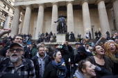 Demonstrators with the Occupy Wall Street rally in front of Federal Hall on Wall Street on March 30 2012 in New York City The demonstrators were...