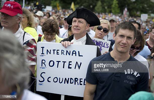 Demonstrators with the Tea Party protest the Internal Revenue Service targeting of the Tea Party and similar groups during a rally called 'Audit the...