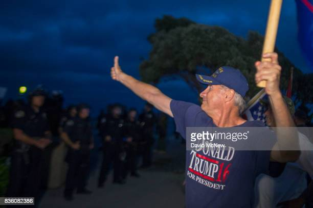 Demonstrators yell at counter demonstrators beyond a police line separating the two during an 'America First' demonstration on August 20 2017 in...