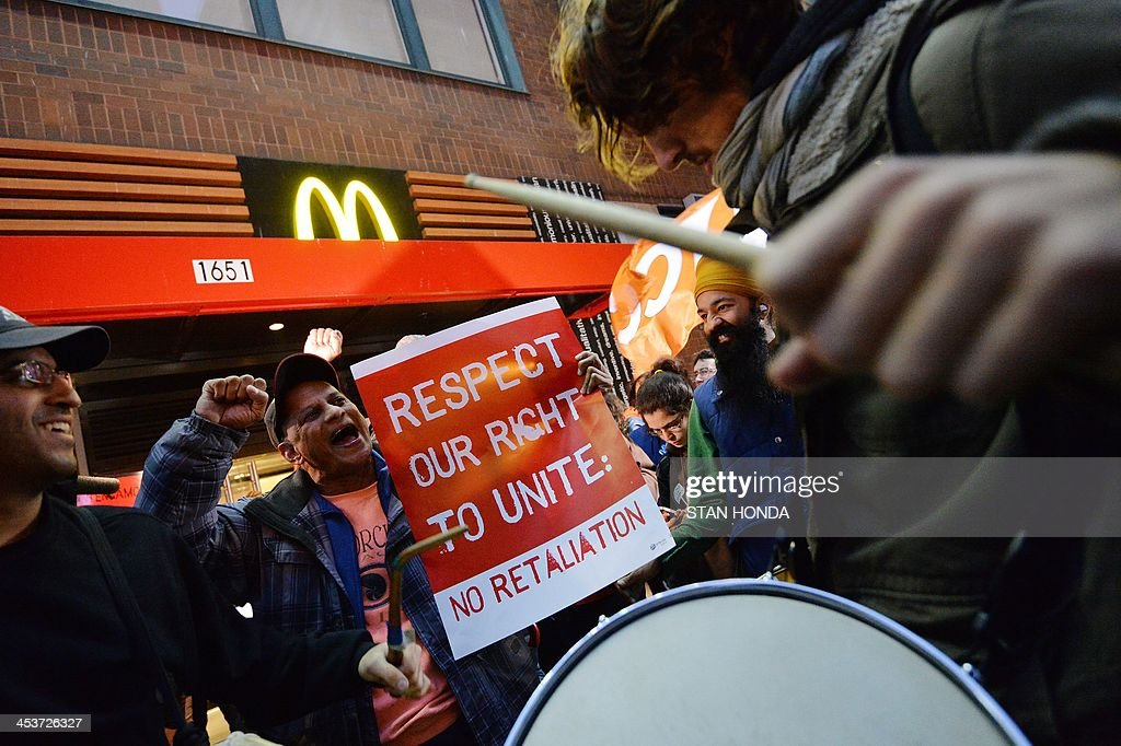 Demonstratorsoutside a McDonald's restaurant near New York's Times Square as part of a nationwide protest of fast food workers December 5, 2013. Fast-food workers say they will sponsor one-day strikes in 100 cities on Thursday and protest activities in 100 additional cities to demand McDonalds, Burger King, Taco Bell, Wendy's and other fast-food restaraunts to pay a $15-an-hour wage. AFP PHOTO/Stan HONDA