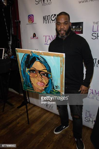 Demont Pinder poses with a painting of Lil Mo' during VH1 'Love Hip Hop' viewing party at Slate on November 20 2017 in Baltimore Maryland