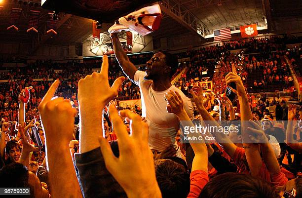 Demontez Stitt of the Clemson Tigers celebrates after their 8364 win over the North Carolina Tar Heels at Littlejohn Coliseum on January 13 2010 in...