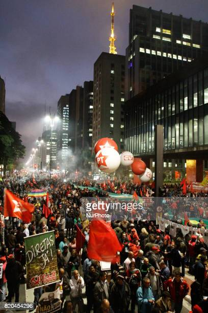 Demontrators take part in a protest against president Michel Temer government's labor and security reforms and against the prosecution of former...