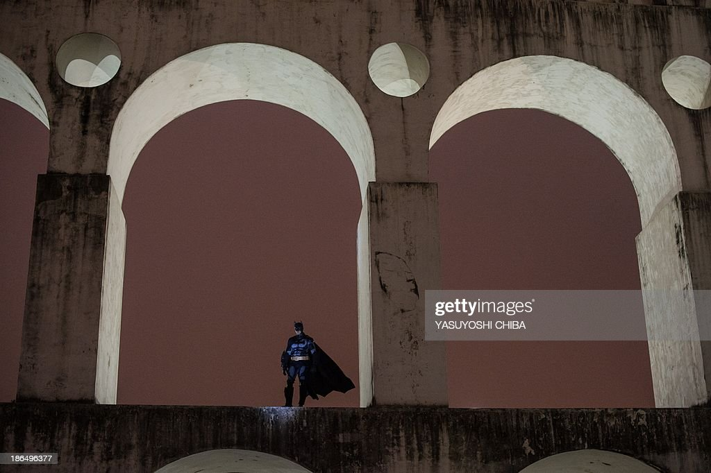 A demostrator fancy-dressed as Batman appears on the arches of the former Lapa aqueduct during a silent demonstration against police violence against protestors, political corruption and demanding better public services in Rio de Janeiro, Brazil, on October 31, 2013.
