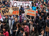 quotNo more stealing no more afp quot and quot Neither private nor state quot Thousand of workers students retirees and families marched in Santiago...