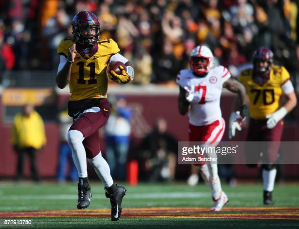Demry Croft of the Minnesota Golden Gophers carries the ball for a touchdown in the second quarter against the Nebraska Cornhuskers at TCF Bank...