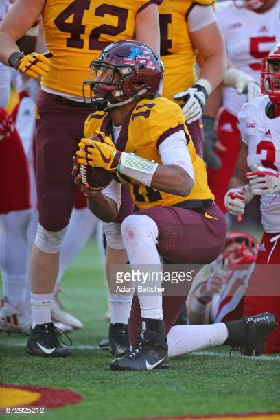 Demry Croft of the Minnesota Golden Gophers carries the ball for a touchdown in the fourth quarter against the Minnesota Golden Gophers at TCF Bank...