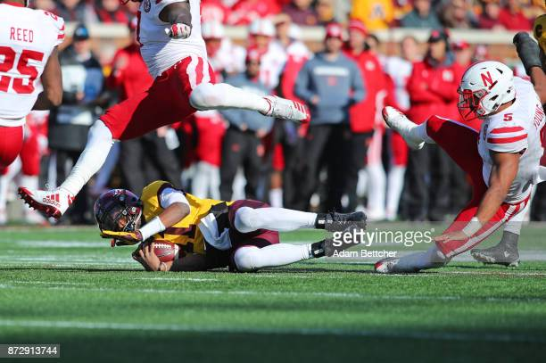 Demry Croft of the Minnesota Golden Gophers takes a slide while advancing the ball in the second quarter against the Nebraska Cornhuskers at TCF Bank...