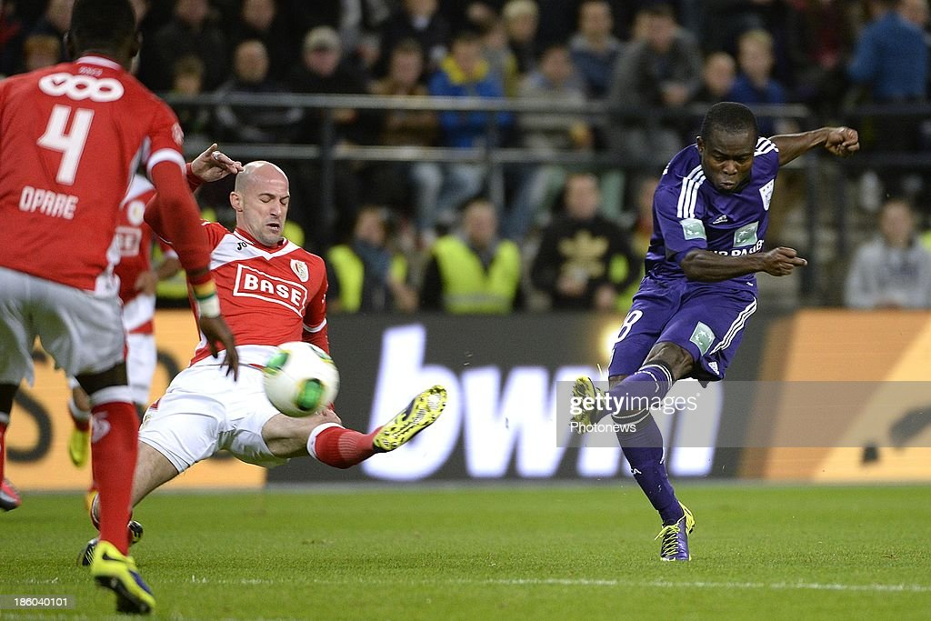 Demy De Zeeuw of RSC Anderlecht and Laurent Ciman of Standard during the Jupiler League match between RSC Anderlecht and Standard Liege on October 27, 2013 in Anderlecht, Belgium.