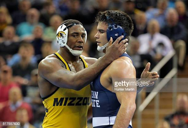 Den Cox of the Missouri Tigers hugs Morgan McIntosh of the Penn State Nittany Lions after defeating him in the finals of the NCAA Wrestling...