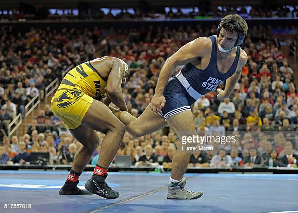 Den Cox of the Missouri Tigers wrestles Morgan McIntosh of the Penn State Nittany Lions during the finals of the NCAA Wrestling Championships on...