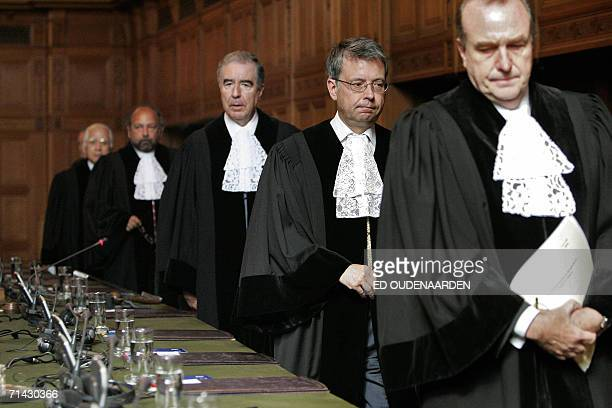 International Court of Justice judges arrive 13 July 2006 for a session in The Hague The ICJ rejected 13 July 2006 Argentina's demand to order...