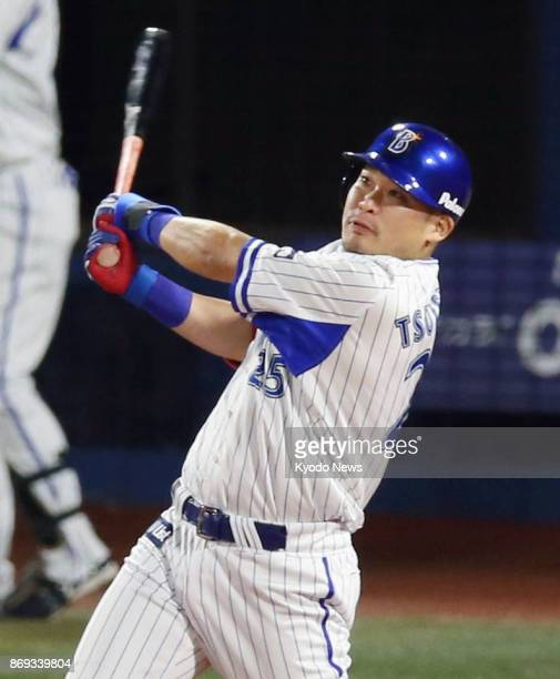 DeNA BayStars slugger Yoshimoto Tsutsugo hits a tworun homer over the centerfield fence in the fourth inning of Game 5 of the Japan Series against...