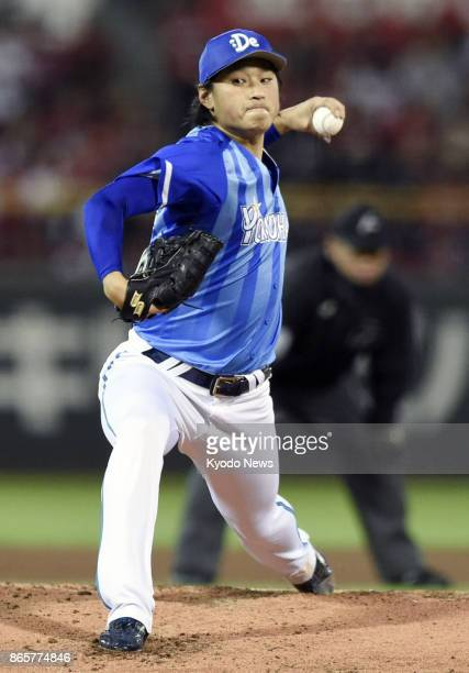 DeNA BayStars starting pitcher Kenta Ishida throws against the Hiroshima Carp in Game 5 of the Central League Climax Series final stage against the...