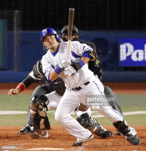 DeNA BayStars' Toshiro Miyazaki hits a gametying single to center in the fifth inning of Game 5 of the Japan Series against the SoftBank Hawks at...