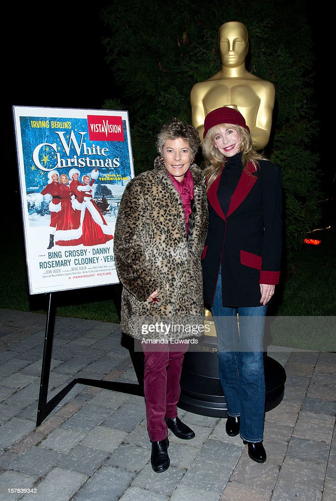 Dena Kaye (L) and actress <a gi-track='captionPersonalityLinkClicked' href=/galleries/search?phrase=Mary+Crosby&family=editorial&specificpeople=799465 ng-click='$event.stopPropagation()'>Mary Crosby</a> arrive at the Academy of Motion Picture Arts and Sciences' Oscars outdoors screening of 'White Christmas' on December 6, 2012 in Hollywood, California.