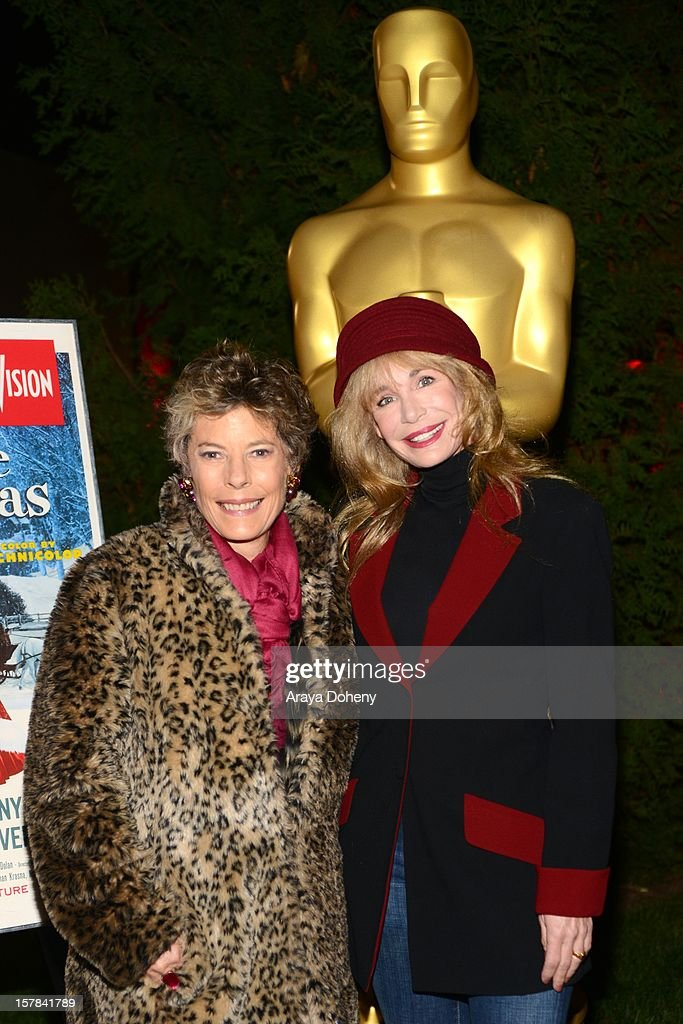 Dena Kaye (L) and <a gi-track='captionPersonalityLinkClicked' href=/galleries/search?phrase=Mary+Crosby&family=editorial&specificpeople=799465 ng-click='$event.stopPropagation()'>Mary Crosby</a> attend the Academy of Motion Picture Arts and Sciences screening of 'White Christmas' held at Oscars Outdoors on December 6, 2012 in Hollywood, California.