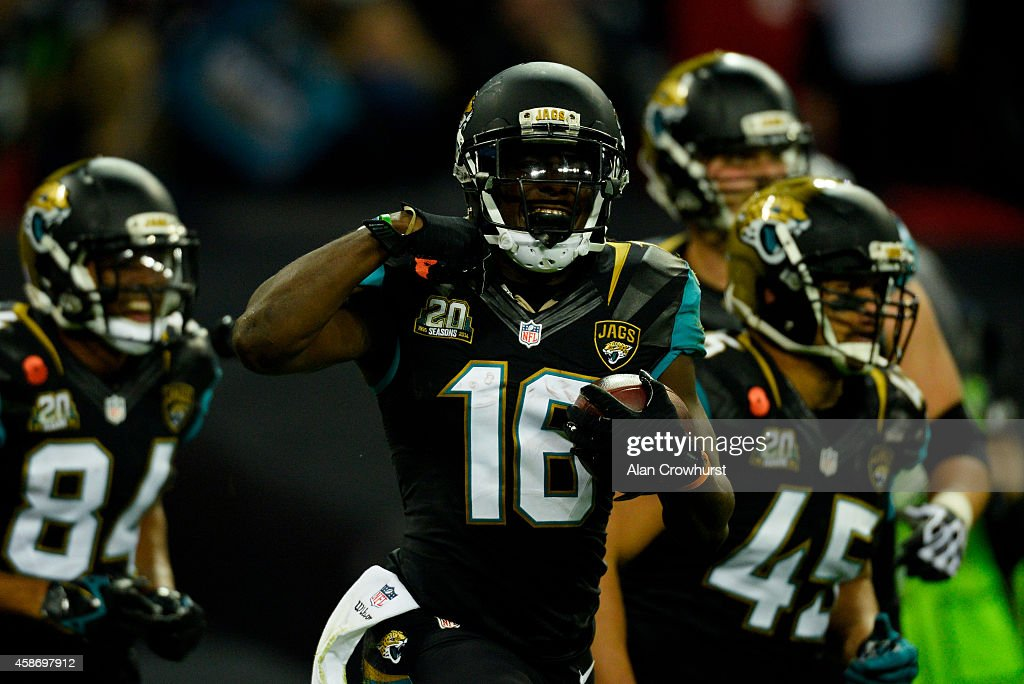 Denard Robinson #16 of the Jacksonville Jaguars celebrates after scoring the opening touchdown during the NFL week 10 match between the Jackson Jaguars and the Dallas Cowboys at Wembley Stadium on November 9, 2014 in London, England.