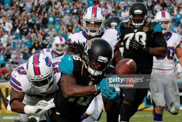 Denard Robinson of the Jacksonville Jaguars fumbles while crossing the goal line during the game against the Buffalo Bills at EverBank Field on...