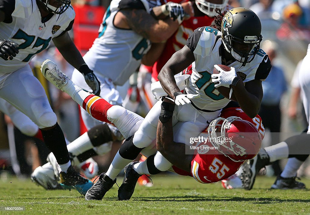 <a gi-track='captionPersonalityLinkClicked' href=/galleries/search?phrase=Denard+Robinson&family=editorial&specificpeople=6234939 ng-click='$event.stopPropagation()'>Denard Robinson</a> #16 of the Jacksonville Jaguars is tackled by <a gi-track='captionPersonalityLinkClicked' href=/galleries/search?phrase=Akeem+Jordan&family=editorial&specificpeople=4293447 ng-click='$event.stopPropagation()'>Akeem Jordan</a> #55 of the Kansas City Chiefs during a game at EverBank Field on September 8, 2013 in Jacksonville, Florida.