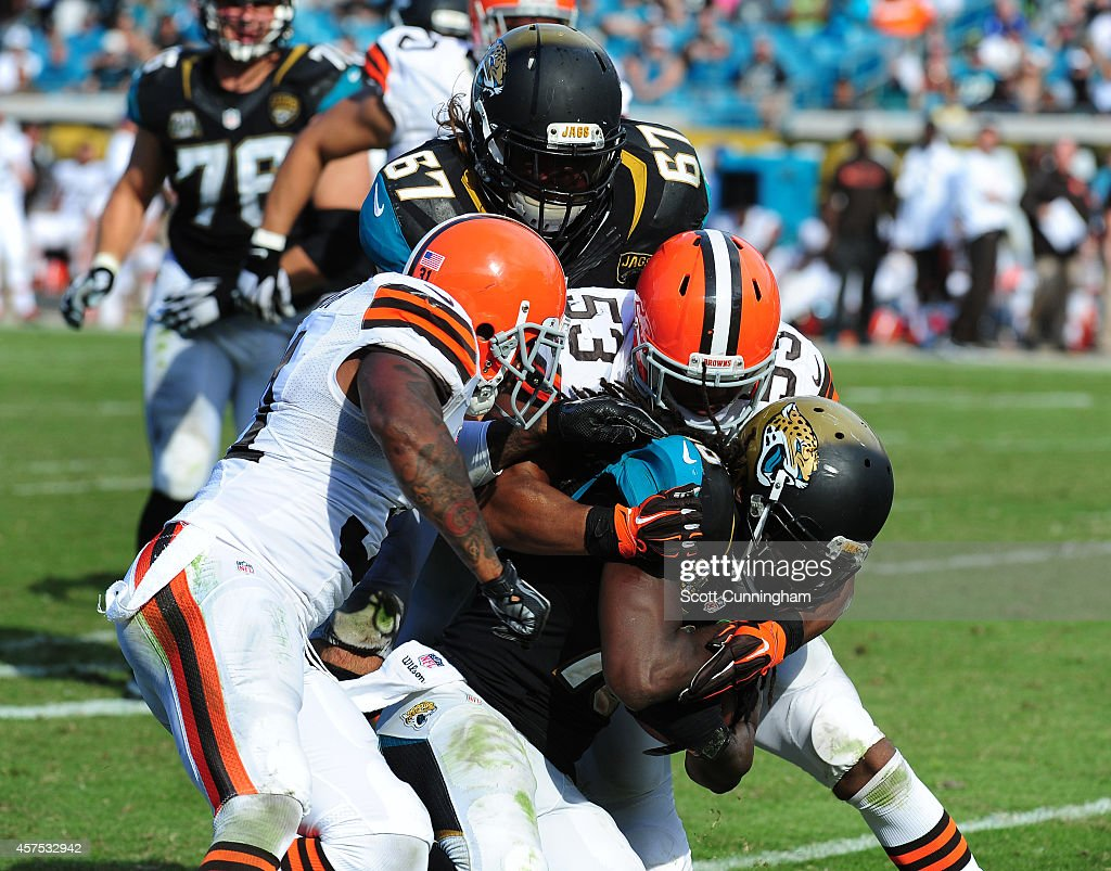 <a gi-track='captionPersonalityLinkClicked' href=/galleries/search?phrase=Denard+Robinson&family=editorial&specificpeople=6234939 ng-click='$event.stopPropagation()'>Denard Robinson</a> #16 of the Jacksonville Jaguars is tackled by Craig Robertson #53 and <a gi-track='captionPersonalityLinkClicked' href=/galleries/search?phrase=Donte+Whitner&family=editorial&specificpeople=649027 ng-click='$event.stopPropagation()'>Donte Whitner</a> #31 of the Cleveland Browns at EverBank Field on October 19, 2014 in Jacksonville, Florida.