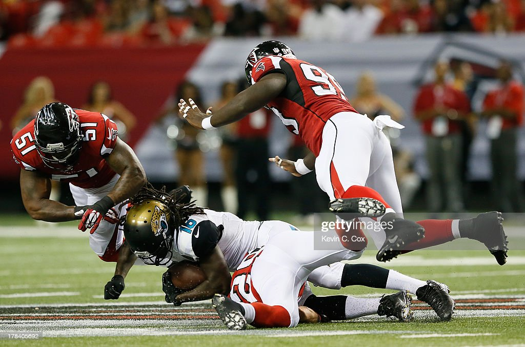 <a gi-track='captionPersonalityLinkClicked' href=/galleries/search?phrase=Denard+Robinson&family=editorial&specificpeople=6234939 ng-click='$event.stopPropagation()'>Denard Robinson</a> #16 of the Jacksonville Jaguars is tackled by Robert James #51, Stansly Maponga #99 and Shann Schillinger #29 of the Atlanta Falcons at Georgia Dome on August 29, 2013 in Atlanta, Georgia.
