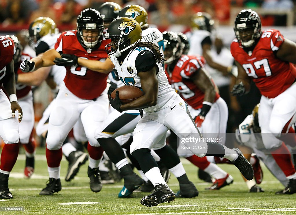 <a gi-track='captionPersonalityLinkClicked' href=/galleries/search?phrase=Denard+Robinson&family=editorial&specificpeople=6234939 ng-click='$event.stopPropagation()'>Denard Robinson</a> #16 of the Jacksonville Jaguars rushes against the Atlanta Falcons at Georgia Dome on August 29, 2013 in Atlanta, Georgia.